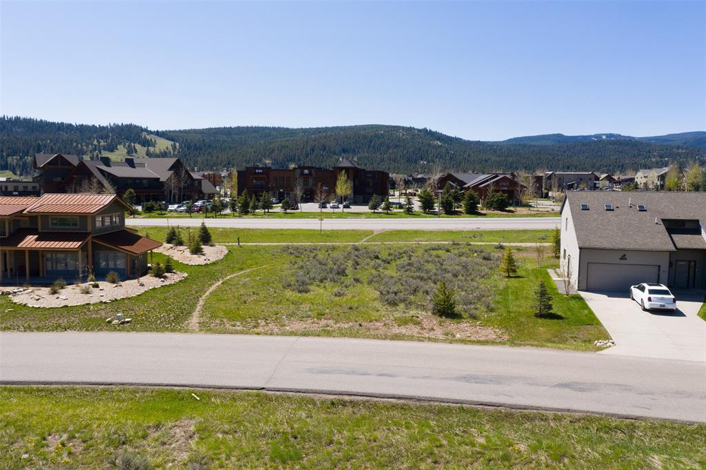 Strategically located in Big Sky, this flat lot is easy to build on and centrally located to take in all the Mountain views, south, north, east and west.  Fiber Optic, Community Water and Sewer District 363, Telephone to the Lot lines.  Winter cross country ski trails or Summers  Stroll over  to the Town Center or onto the Meadow Village Golf Course.  Easy to view; homes on both sides.