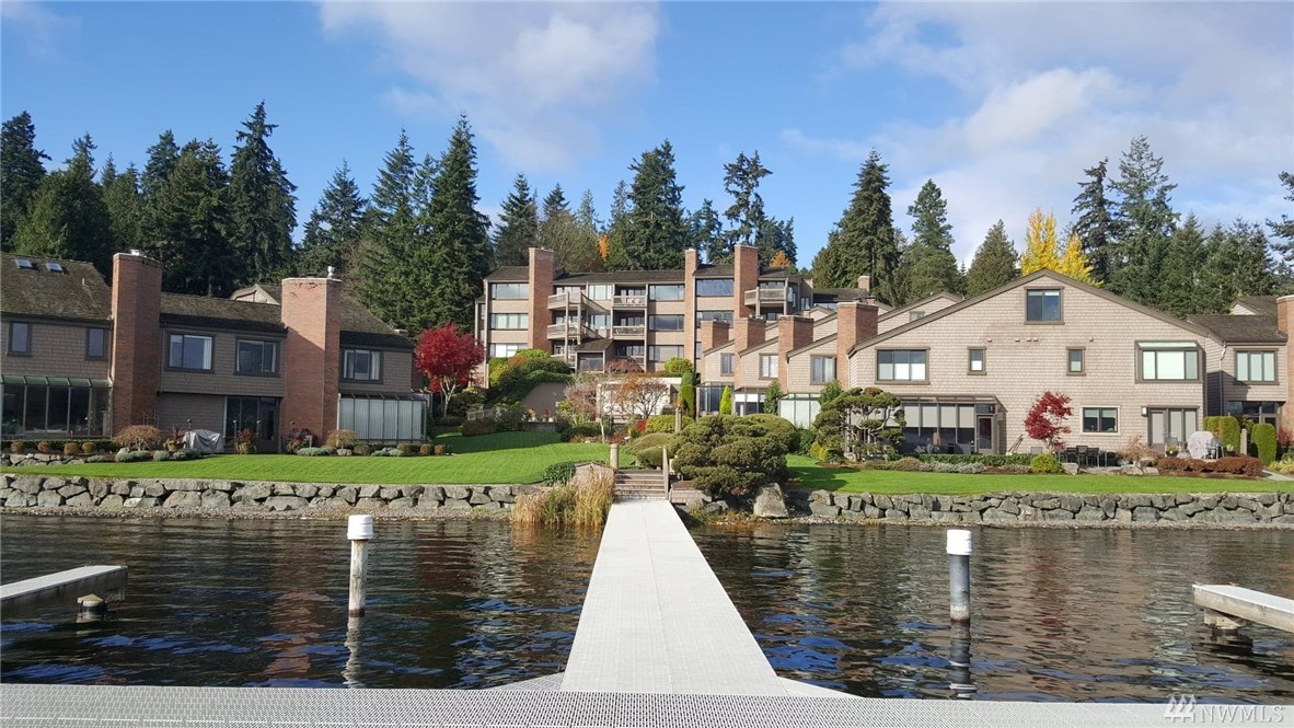 Back on Market.  Lakeside living! Stunning fully updated townhouse in highly coveted Sammamish Shores Gated, waterfront community + dock, pool & hot tub. Open floorplan to enjoy lake/pool views.   Great rm w/adjoining media & dining rms, has a f/p,+ nearby deck & chef's kitchen. Enjoy  lake view office, which can act as bdrm. Master w/ f/p, views & 5 pc bath. lush, .5 acres of gorgeous manicured waterside grounds with a picturesque stream. Boat dock w/ slip included. Come home to the lake!