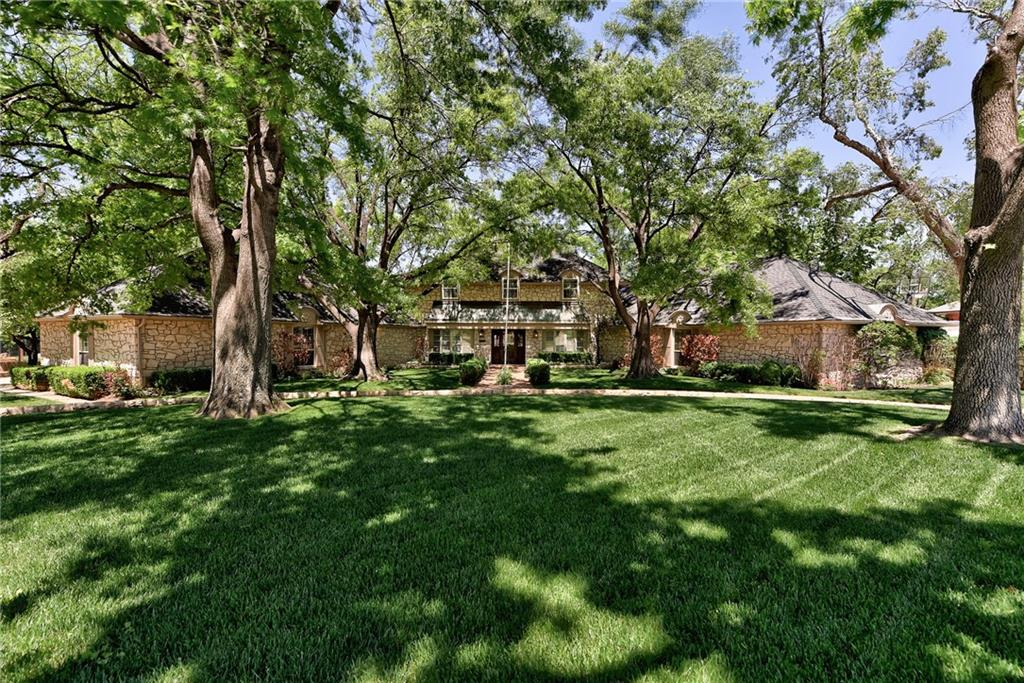 Fabulous oasis on nearly 1 acre in Quail Creek! Large estate home ready for you to make it yours. Spacious rooms including 4 bedrooms & 3.5 baths. Kitchen featuring travertine countertops, double ovens & walk-in pantry. Open living and dining with fireplace & wet bar w/marble countertop.  Large sun room on back of home w/lots of natural light. Another large & cozy Den downstairs features an oversized stone fireplace, beautiful wood work & wet bar. Downstairs is the large owner's suite with 2 walk-in closets. Work from home with the private office next to owner's suite. Upstairs offers 2 bedrooms with a Jack & Jill bath & a 3rd bedroom ensuite & walk-in closet. Plenty of space awaits you! This backyard is a haven, with a large pool, tons of lounging space, an unfinished cabana with a 1/2 bath, gardens & plenty of yard. It's heavily wooded around the property offering plenty of privacy. Make this your own personal escape!