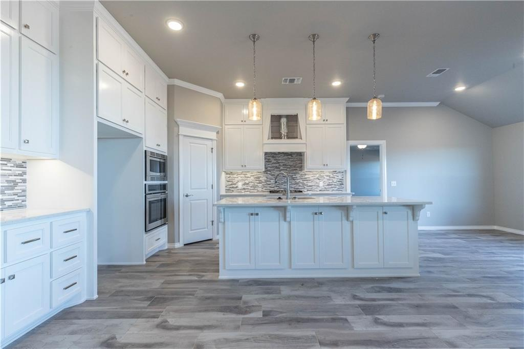 This Hazel Half Bath floor plan includes 2,125 Sq Ft of total living space, which includes 1,950 Sq Ft of indoor living space and 225 Sq Ft of outdoor living space. There is also a 570 Sq Ft, three car garage with storm shelter. Home includes 4 bedrooms, 2 full bath, and a half bath. Living area includes a gorgeous corner fireplace with modern mantel, 3 large windows, great source of natural light, & barn door! Kitchen has an island, 3CM quartz counter tops, stainless steel appliances, decorative tile back splash, corner pantry, and beautiful shelves, wonderful for extra needed storage . Master suite features a boxed ceiling detail with crown molding and bathroom featuring separate vanities, large walk in shower, whirlpool tub and spacious walk in closet! Master closet has a connection to the utility room! Covered back patio with outdoor fireplace. Home has Rinnai Tankless water heater, whole home air purification system, R-44 insulation and Solarboards.