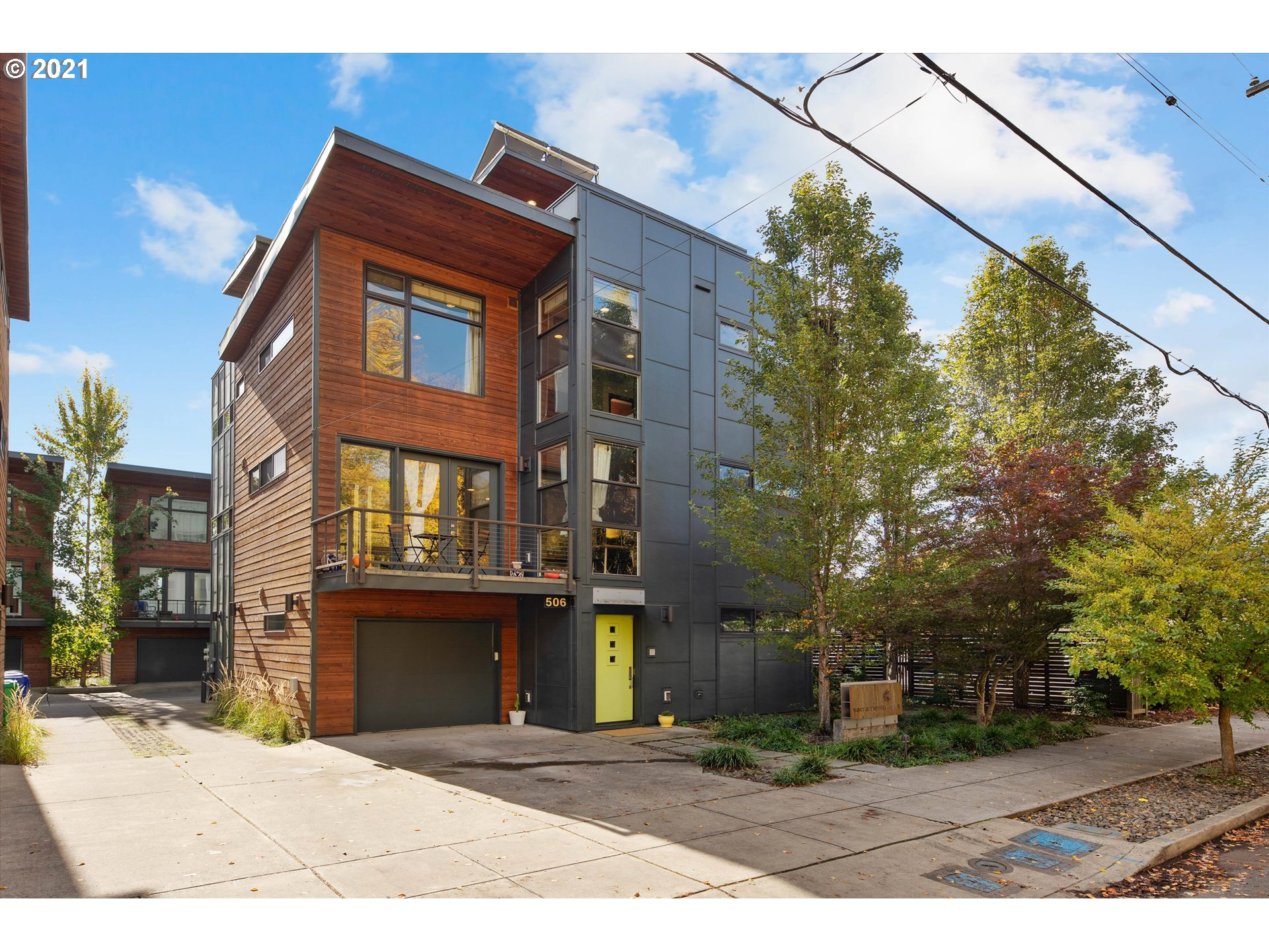 This dynamic, modern architectural gem is truly special. Ecologically built in 2009 in the heart of NE Portland, this four story townhouse has panoramic views of the city. Polished concrete/wood floors with radiant heat, floor to ceiling windows, open spaces with a superb layout. Main floor bedroom suite is perfect for WFH office or guest space. Gorgeous kitchen with handmade wood bar and half bath. Two suites on the the 3rd level with laundry. Upper deck, one car garage and your own elevator!