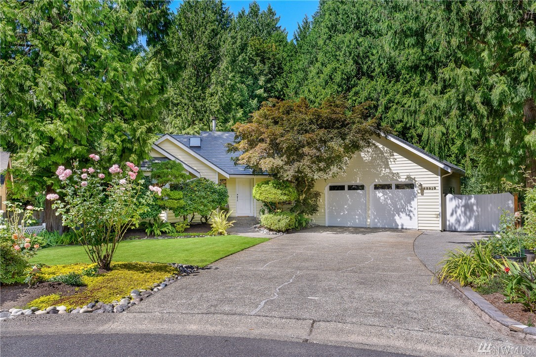 Amazing home in the heart of Sammamish–First time on the market in 33 years! Total pride of ownership is evident throughout this wonderfully maintained home with a 50yr roof. Open concept kitchen/living room, perfect for entertaining, you'll love the fireplace for those chilly PNW nights.  Front and back yards are a gardeners dream featuring a custom trex deck, multiple patios, you must see to appreciate. Minutes from parks, shopping, and amenities. Award winning Lake Washington School District.