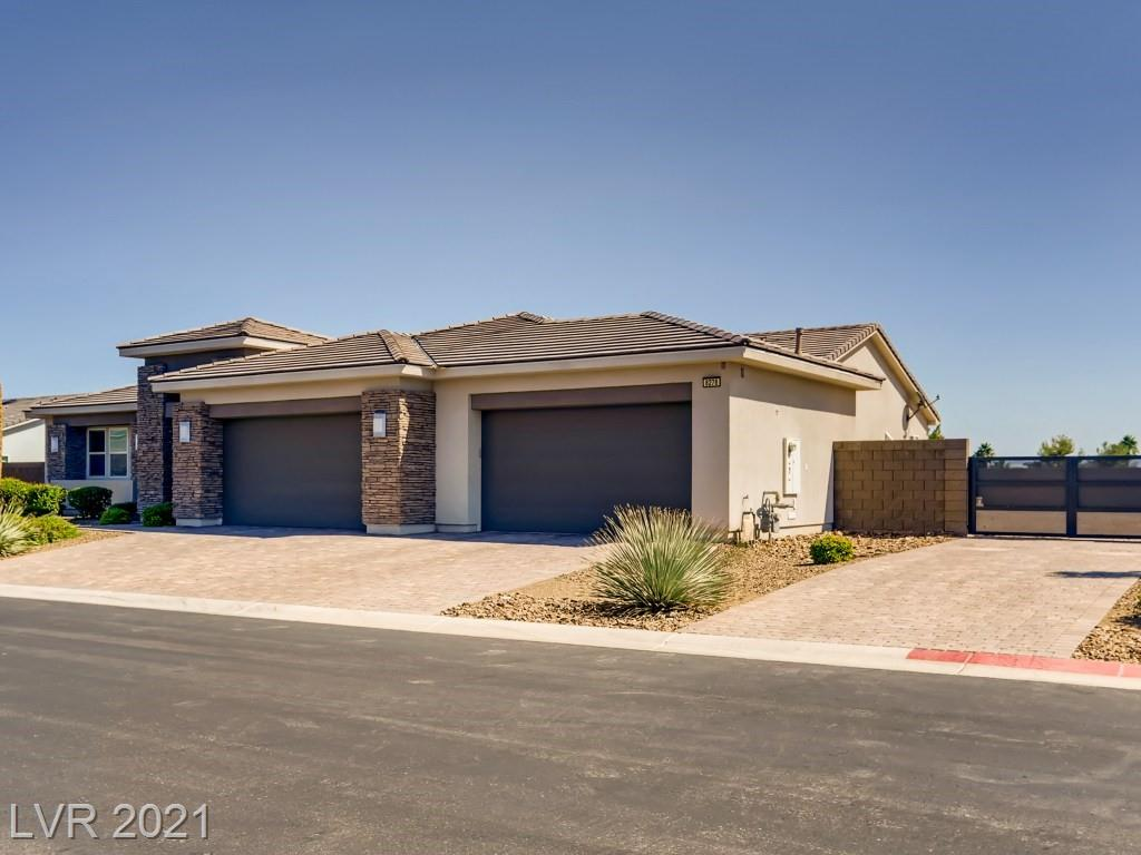 Stunning single story home on almost a 1/2 acre with RV Parking in Las Vegas!  This sweet gem features 4 beds (2 of which are master bedrooms), 3 1/2 baths, tile floors, den or formal dining area, chef's dream kitchen with breakfast bar - oversized island - walk-in pantry - nook - stainless steel built-in appliances, spacious master suite w/ a luxurious bathroom w/ custom shower and separate soak tub, prewired for security and surround sound, 16X27 ft living area with gorgeous floor-to-ceiling glass pocket doors which lead out to the outdoor living space that includes a covered patio, refreshing pool, zen waterfalls, spa, fire pit, sunning area, and a huge side yard for an RV Shop, extra garage, or a play area for your pets and kids.  This ranch has a 4 car garage, paver driveway, pre-plumbed for solar, and in a gated community off Windmill and Durango just minutes to LV strip, freeways, fine dining, shopping, and schools!