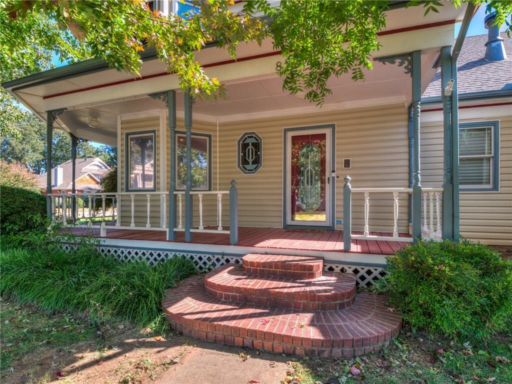 This gorgeous Victorian Home rests on a corner, quarter acre lot. The wrap around porch allows you to take in the serenity of the neighborhood. Upon entry, you are greeted by a grand staircase & sitting area/office space. Also on the 1st level, you will find the expansive living area complete w/fireplace, built-in shelving, & mantle. Not far off is the open dining area & kitchen that includes an island, ample storage & counter space, granite counter tops, & multiple ovens! The Master suite is also on the lower level w/gas fireplace & walk in closet. Completing the interior of the home are 3 more great sized rooms & a fully loaded laundry room w/utility! Outside a covered patio, in-ground pool, & hot tub for you to enjoy year round! A few more bonuses include tons of attic & storage, Plantation shutters throughout, whole house home warranty, & includes an AirBnb track record! Conveniently located only minutes from OU, shopping, entertainment, & major highways.