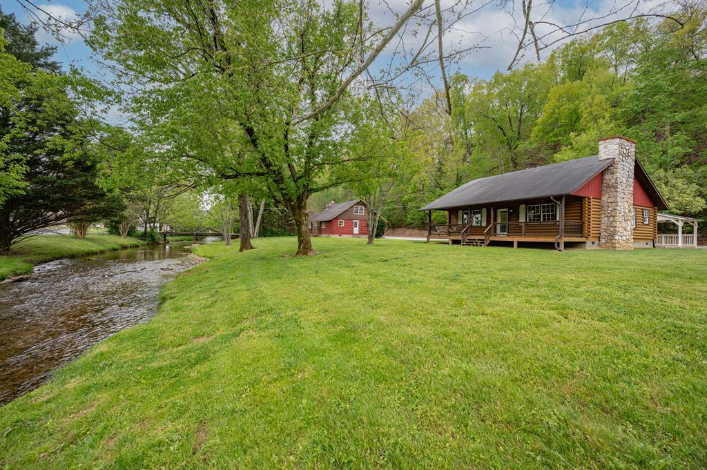 An incredible creekside property, zoned C-6 in the heart of Pigeon Forge, yet as tranquil and serene as can be.  Two cabins, one ready to furnish, the other ready to finish make up this rare offering.  Walk out the front door to the Island and the Pigeon Forge Parkway in a matter of minutes.  Publix and several restaurants all a stone's throw away.  While there is obvious potential in overnight rental with these cabins, its C-2 zoning and access to utilities also make it a prime location for an even bigger project.  The huge lawn and vast area currently used as parking await your imagination!  The first cabin is ready to furnish with 2 bedrooms and 1 and 1/2 baths.  The second has been prepped for remodeling, including electrical service and an upstairs suite.  Pick your floors, fixtures and walls and you'll be ready to release one of the hottest rentals in Pigeon Forge, onto the marketplace.  A detached 1-car garage would make a sweet outdoor gameroom or party pavilion for you or your guests.  Looking for a place to live onsite while operating your own overnight rental?  You found it here.  Come explore the grounds, admire the beautiful creek, and let your imagination run wild.