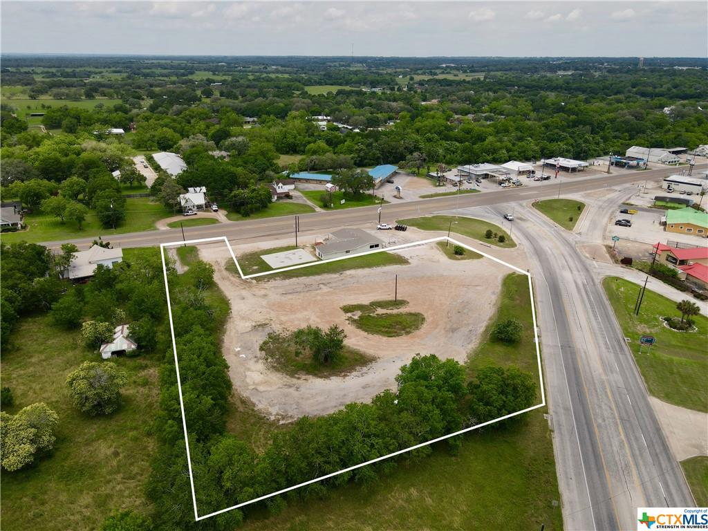 Tract #1- Undeveloped 2.5 acre +/-  tract of land ready for commercial development, in a prime location with excellent exposure near the busy intersection of State Highway 90A & State Highway 77S. State highway frontage on US Hwy 77S and US Hwy 90A in Hallettsville, Texas. Several hotels, restaurants, retail businesses & a large venue nearby. Some restrictions apply. Within the city limits and access to all city utilities. Survey needed. Easy access to Interstate 10, Victoria, San Antonio & Houston. An additional 2.5 acre tract is adjacent to the property and also available.
