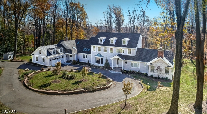 Suburban Oasis, Shingle Style, renovated and updated 2018. Year round enjoyment indoor heated pool w/ sliders to terrace, Sauna, Full Bath/Dressing Rm. Gorgeous designer Kitchen w/island & skylights. Wolfe Range, pot filler, dualtemp.wine cooler, White Dolomite counters, marble backsplash, French doors from BK room to Portico & expansive bluestone terrace. Side entrance to mudroom & rear stairs. Adjacent to Kitchen, Family Room w/FP, formal DR floor to ceiling bay window, LR, Bay window, FP, Stunning 1st fl.Primary Bedroom & spa-like Bathroom suite, 2 walk-in closets, FP, tray ceiling w/lighting. 2nd.fl. laundry rm, 4 bedrooms, 2 bathrooms, stairs to full height attic. Custom Front door w/leaded glass, Indoor Pool 46' x 24', New Roof, exterior painted 09/2020, 2017 6BR. Septic, New stone columns at entrance.