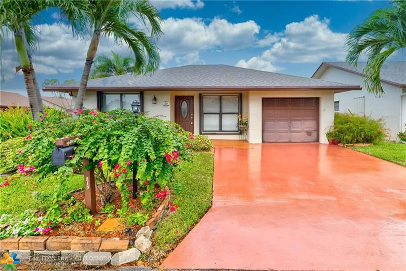 """Welcome home to this pristine and expanded 2/2 with HUGE 22 X 12 FAMILY ROOM/FLORIDA ROOM overlooking tropical paradise. Major items all replaced, ROOF, AIR CONDITIONER & WATER HEATER 5 YRS young. No worries here! OVER SIZED Living area with pretty 20"""" tile throughout makes entertaining a breeze!  Updated and open kitchen with granite counter tops.  Wood laminate in MASTER SUITE and guest bedroom. Master Suite has a closet for any fashion lover.  Master bath with stall shower, separate vanity.  Guest bath has tub.  Sunny southern exposure to capture the warm sunlight on your front porch. LARGE CORNER LOT with tropical landscaping. Screened front door to capture the southeast breezes. One car garage with driveway parking for two vehicles. Meadow Lakes has LOW HOA that includes cable."""