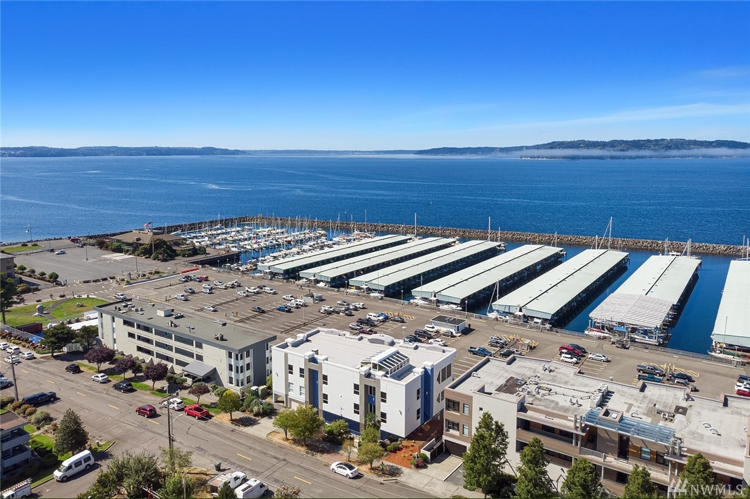 Completely remodeled 2 Bedroom, 2 Bath condo in the heart of Des Moines w/ 180 degree views of the Marina, Puget Sound & Olympic Mountains. All new wood flooring, custom white mill work, floor to glass windows. Chef's kitchen w/ commercial grade hood, SS appls, quartz cntrtops, mini-split A/C systems. All new bathroom features tiled floors, custom cabinets, walk in glass enclosed shower to the custom soaking tub. Private deck for entertaining. Secured garage with 2 parking space. Move in Ready.