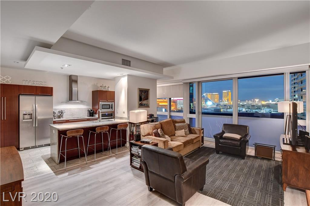 Situated on the 8th floor of the luxury high-rise community of The Martin, unit 807 features two bedrooms and two bathrooms, and an open concept main living area. Floor to ceiling windows with automatic drop shades provide picturesque views of the world famous Las Vegas Strip and west Las Vegas valley. This sought after unit covers 1,437 square feet. Gourmet stainless steel appliances, along with custom soft-close cabinets and granite countertops highlight the contemporary kitchen. On-site storage unit included with unit 807. The Martin boasts luxurious amenities making it one of the premier high rise condominium residences in all of Las Vegas. The Martin provides its residents with a resort pool with poolside cabanas, tranquil garden lounge, fully equipped fitness center and spa, library and business center, as well as valet parking and 24-hour security and concierge services. Situated blocks from the Las Vegas Strip, world-class shopping, dining and entertainment are minutes away.