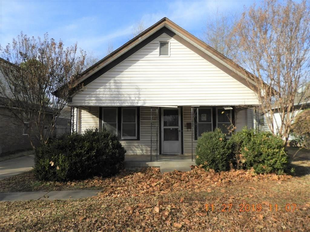 Location, location, location!!  3 bedroom, 2 living area's, 1 bath and 2 car detached garage only blocks from Oklahoma University!!  Large covered front patio!!  This home has tons of potential!!  All offers must have proof of funds....  Buyers to verify heat source...