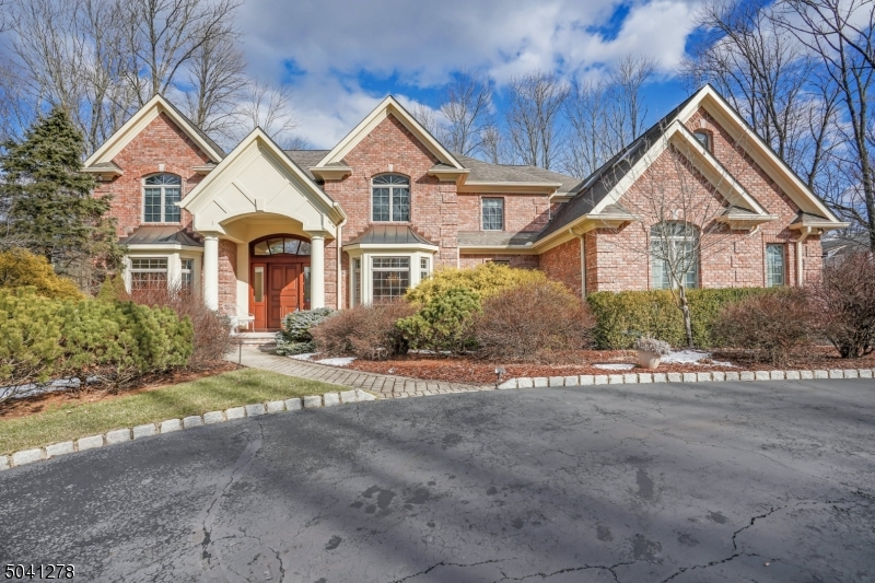 """Welcome to this 4 sided custom brick beauty! This amazing home is located across the street from The Watchung Lake Park. Minutes from tennis, basketball, fishing, fitness circuit, and much more. This wonderful home offers the luxury of space with this optimal floor plan. The first floor is complete with a guest suite with its own full bathroom and walk-in closet, a custom library (which would make a perfect """"Zoom room""""), and a sunroom where you can enjoy quiet afternoons. I fell in love with the double-sided fireplace (1 of 4!) in the living room/great room.   The expansive master suite with fireplace, 3 WIC, sitting room & work-out room. You will love it! The finished walkout lower level with its own full bathroom completes this amazing home."""