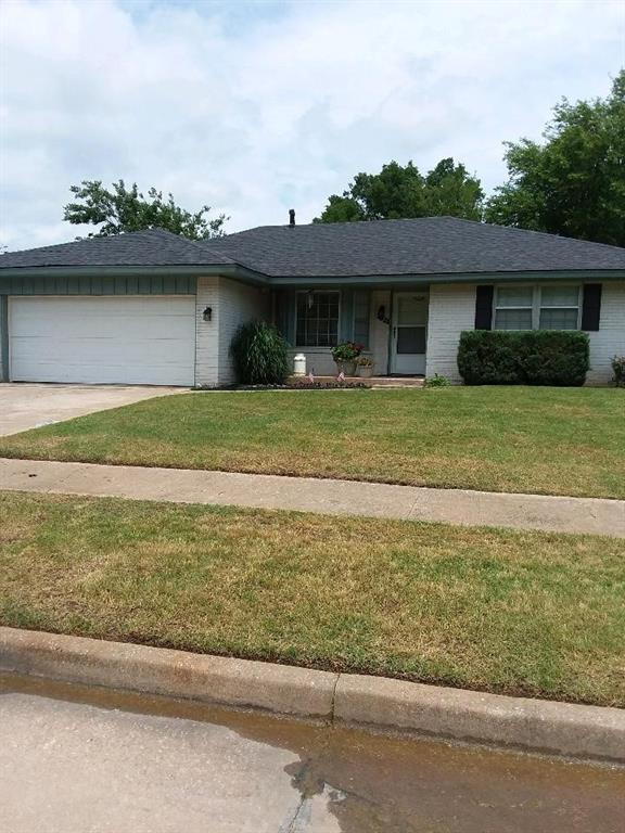 Come see this great buy with a total kitchen update in 2019 - custom cabinets, marble countertops, stainless appliances, pantry, breakfast-bar as well as eat in kitchen. Large open living area, fireplace with gas insert, lots of windows with  wooden blinds. nice sized bedrooms and 2 full baths. Big backyard and pretty landscaping. A little lipstick and it's move in ready.