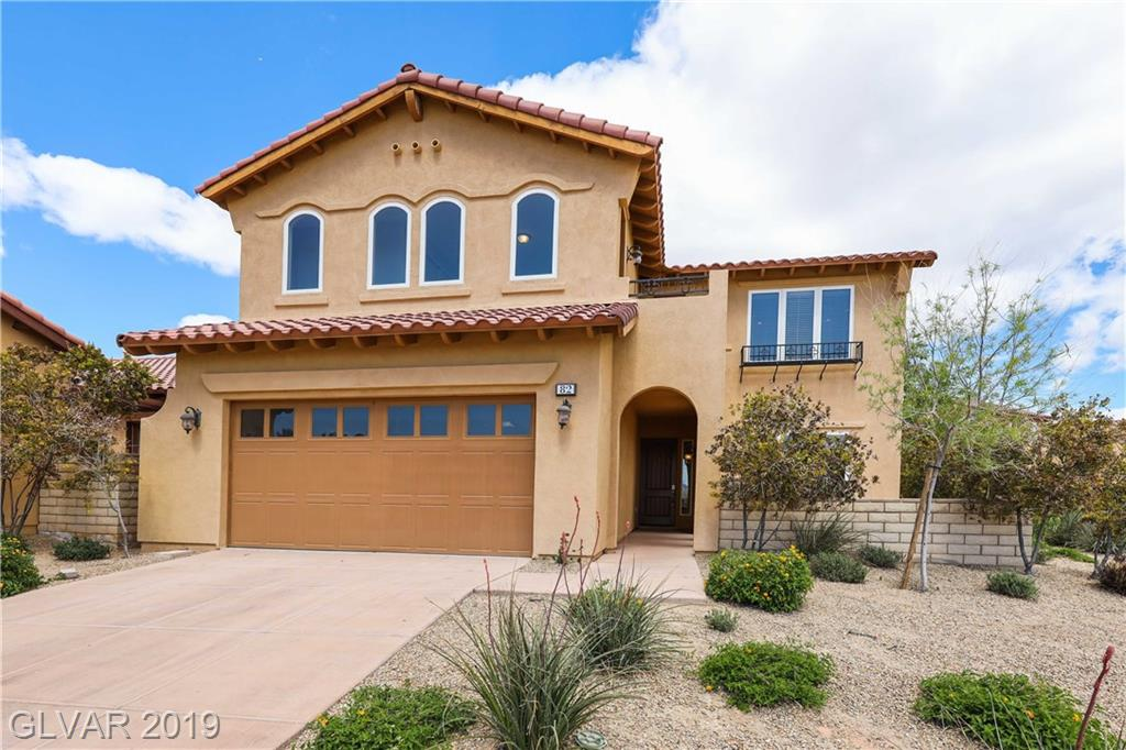 Stunning TWO STORY 3BDRs & 3½BTHs HOME in Lake Las Vegas! Amazing estate on a corner lot w/priv. courtyard, golf course & mountain views. Airy Great Rm & cozy fireplace. Gourmet Kitchen w/island, breakfast bar, lavish granite cnts, dbl ovens, cooktop & eat-in Dining area. Master BDR downstairs w/walk-in closet, retreat & patio. Gorgeous wrought iron staircase takes up to Loft & 2BDRs w/its own BTHs plus balcony. Resort living w/amenities & lake.