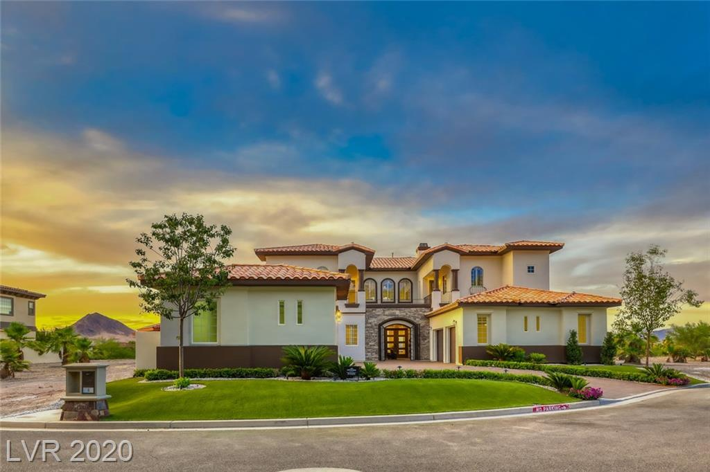 Stunning custom estate with breathtaking lake,mountain & golf course views beautifully poised in exclusive Lake Las Vegas SouthShore. Exquisitely & completely renovated with modern touches and no detail overlooked.Enter the courtyard with the tranquil sounds of the fountain into the threshold of a 5 bedroom masterpiece with open floor plan that is meant for entertaining and your private personal retreat. Family room with fireplace & wet bar. Formal dining room with wine cellar to showcase your collection. Upstairs master with spacious spa inspired bathroom with fireplace.Master balcony overlooks majestic views of Lake Las Vegas, mountains and SouthShore golf course.Backyard sanctuary with pool that include fire & water features, spa, built in BBQ and a fire pit is the perfect ingredient for desert living. Four car garage and spacious driveway offers plenty of room for your special vehicles and toys. Live your dream!