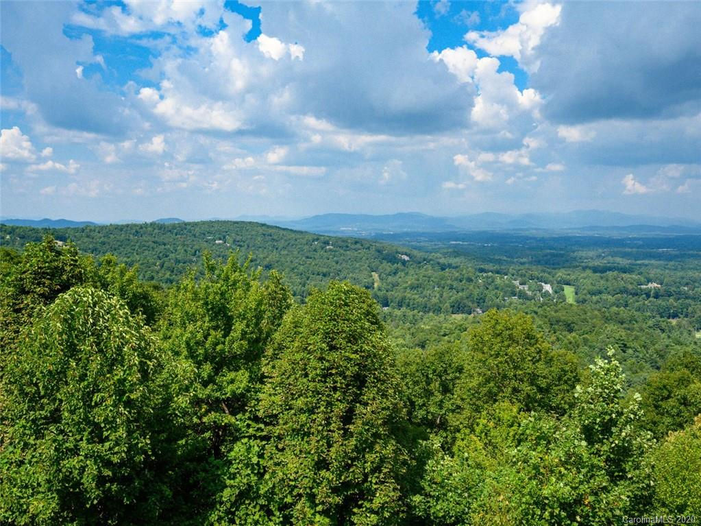Sweeping long range views on this 1.53 acre lot located in prestigious Kenmure, a gated golf course community. One of the best view lots available. Build your dream home and enjoy spectacular northern multi-range views. Ideal for a walkout basement floorplan. Surrounded by some of Kenmures finest homes. Approximately 162' road frontage.  Underground utilities, city water and natural gas available. Amenities include golf course, tennis and pickleball courts, indoor and outdoor pools, fitness center and antebellum clubhouse. Membership in the club is optional. Very convenient to entry gate and clubhouse.