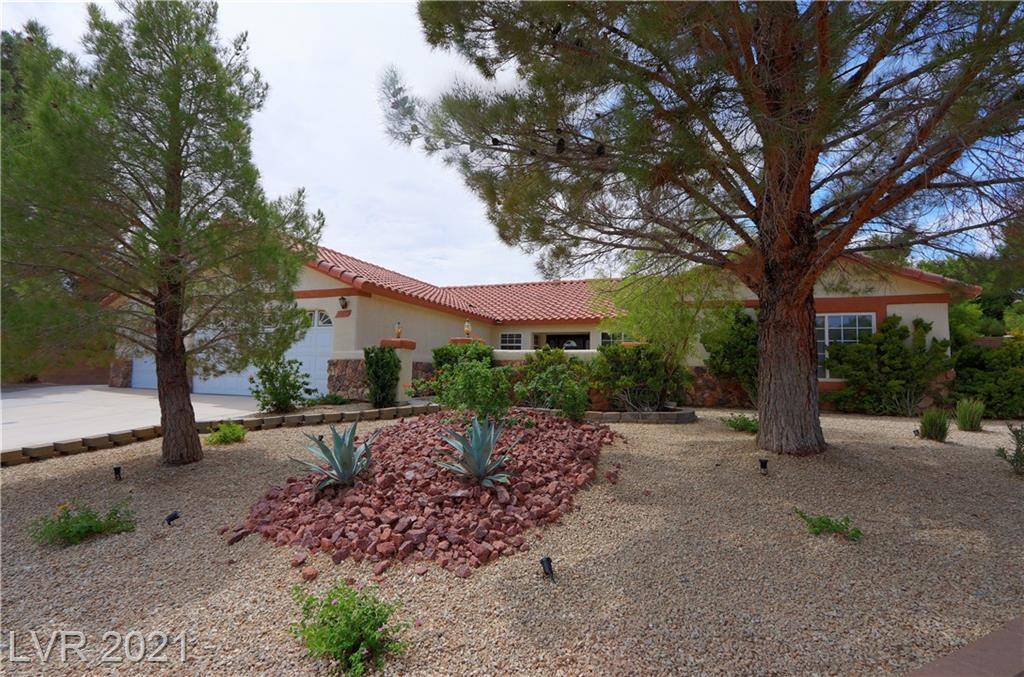 This Single story home has room! A nice desert landscaped front yard greets you. Large detached workshop with it's own easy access gate to the street and a 3/4 bath. RV gated area has tons of room for toys. The back and side yard are Great Entertaining areas with bars and seating, under both of the patios. Mature landscaping and a green yard!  Vaulted ceilings throughout! The Great room features a stone fireplace. Large Primary Bedroom with a large walk-in closet, 2nd bedroom has a walk in closet. Den could have been the 3rd bedroom. Home is Sold as-is.