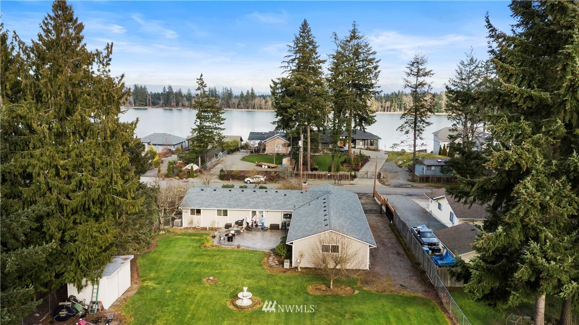 TACOMA POINT CUSTOM RAMBLER! All the amenities of living at Lake Tapps at your fingertips and partial lake view! Community lakefront park w/ boat launch conveniently located across the street! This one owner home boasts over 2,300 sq.ft. of living space, including a HUGE family/rec room. French doors lead to amazing outdoor living accented w/ stamped patio & gas firepit. Handmade electric ornamental side gate for boat parking! Custom walnut cabinets thru-out! Wired alarm system! Wired surround sound! 2-car oversized garage with handyman workbench! BRAND NEW 30-year roof! Parcel is subdivided. Back building lot available for purchase (see MLS #1736868 for more info). Voluntary HOA ($110 year - keys to parks). Don't let this one get away!