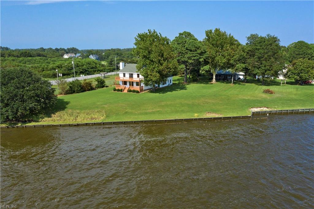 Beautiful, well-maintained farm style home over looking the Currituck Sound and Intra Coastal waterway. House was built by a highly sought after local builder Jimmy Cason. Locals say the house sits on the highest point on Knotts Island and does not require flood insurance. House has 2 amazing porches (up and down) that have panoramic views of the sound. Master bedroom is completely open to the water view with its own deck. other bedrooms also have a water view. House has a geothermal HVAC source so electric bills are very low. Kitchen has been updated and looks new. House does have a fireplace flew for a wood burning stove. House does have a separate in-law suite opposite of garage with its own full bath. Lots has about 120 feet of bulk head. This area has been called the Sportsman Paradise. Hunting, fishing and crabbing is tremendous. Sound bottom is sandy which makes it nice for water sports. 20 min boat ride to Carova Beach. Lots of deep water for easy access to the beach!