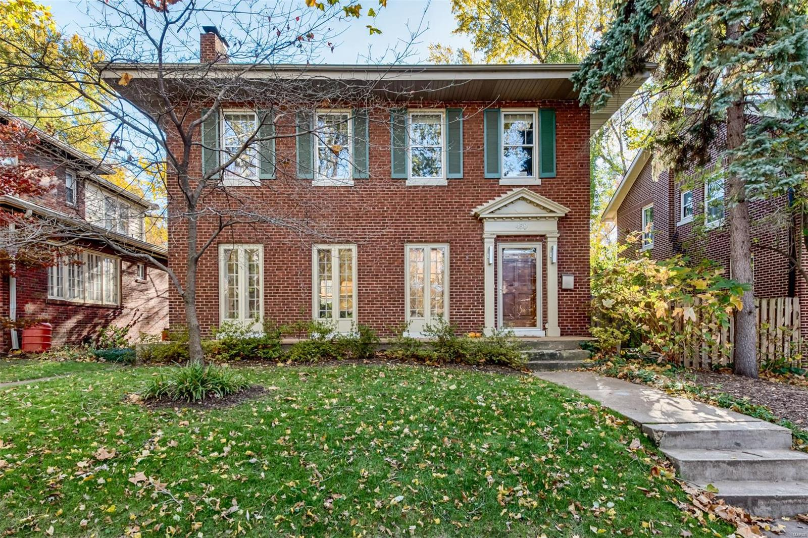 Located in the popular Ames Place neighborhood is this bright and happy home.  Easy access to Washington University, Metrolink and Forest Park via the skywalk.  Also a quick walk to the Delmar Loop with its vast array of restaurants, coffee shops, a movie theater, grocery store and more. The home features a living room with French doors and fireplace. Large, bright dining room.  Eat-in kitchen with custom, ceiling-height wood cabinets and gas stove. Off of the kitchen is a screened porch that overlooks the fenced yard. Upstairs there are 4 bedrooms with the master featuring a custom Ikea closet. There is also a covered porch off of a bedroom. Oak hardwood floors throughout the main and 2nd levels. 2-car garage.