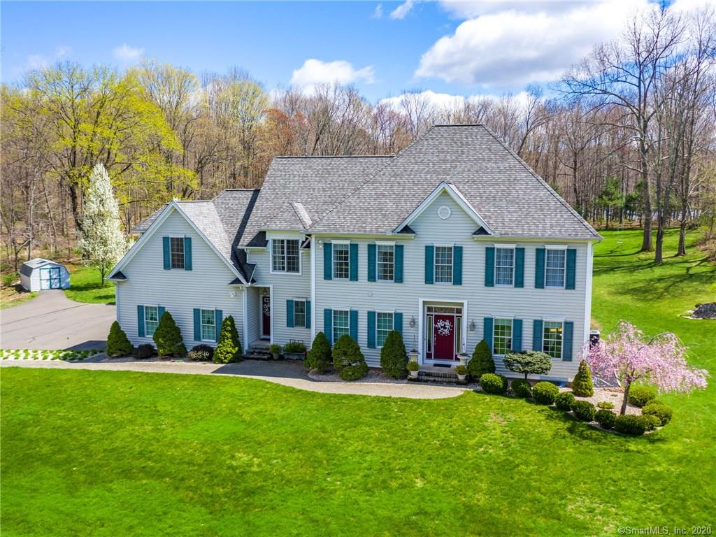 PRIVATE & SPACIOUS!! If you are looking for privacy then look no further than this custom colonial situated on 4.7 acres!! This home is adjacent to a wooded area of over 300+ acres of Sunset Rock State Park. It is located well off the road and is at the end of a long, shared driveway. I-84 and a shopping center are 1.5 miles away. The eat in kitchen features granite counter tops, sky light, tile flooring &  back splash. The kitchen is spacious and open to the inviting family room with a wood burning fireplace. The combined dining/living room features hardwood floors and plenty of windows for natural sunlight. The two-story entry way has tile floors and a wrought iron railing along the staircase that leads to the second floor. There are plenty of closets and storage spaces throughout. The laundry room is located on the main floor with plenty of cabinets. The master bedroom features a walk-in closet and attached bathroom with Jacuzzi tub, double sinks and stand-up shower.  There are also two additional bathrooms on the second floor that have sky lights. The possibilities are endless for the large bonus room over the garage. The 3-car garage has plenty of room for additional storage. Enjoy your time exploring the trails of Crescent Lake located a short walk through the back of the property. Feel like relaxing in a hot tub? There's one located on the expansive, private patio. If you're looking for privacy in tranquil surroundings, look no further than this home's unique setting!