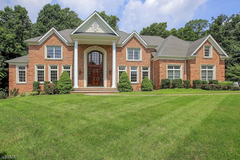 Best Value!... 4-sided Brick 5BR 5.1BA Colonial located in top neighborhood - Castle Ridge Estates. Gorgeous curb appeal & surrounded by other luxury homes. 5800+ sq ft + finished daylight basement! Dramatic 21' high, coffered ceiling in Family room w/ floor to ceiling picture windows! Fine finishes, from crown, picture box moldings on 3 levels! Hardwood floors on 1st & 2nd levels! Windows surround the LR, DR & large Office. Chef's Kitchen is truly the heart of the home; huge center island, top of the line appliances & 2nd family rm (den). 1st fl in-law suite w/full bath makes it convenient for guests to visit. MBR is a retreat w/sitting rm, 2 large walk ins & MBATH. Convenient upstairs Laundry. Finished daylight LL w/ rec rm & bonus rm + storage. Beautiful level 1.26 acre lot. Paver driveway.