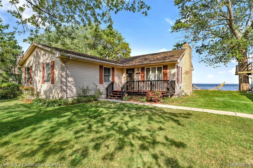 **AMAZING 1386 SQ FT RANCH WITH INCREDIBLE LAKEFRONT UNITERUPTED VIEWS OF LAKE ERIE AND CANADA**SUPER CLEAN**VERY OPEN FLOOR PLAN**LARGE LIVING/FAMILY ROOM WITH FIREPLACE AND A SLIDING DOOR WITH STUNNING VIEWS**TONS OF NATURAL LIGHT THROUGHOUT ENTIRE HOME**NICE SIZE CUSTOM KITCHEN WITH APPLIANCES STAYING**SPACIOUS AREA FOR POSSIBLE DINING ROOM**ONE FULL AND ONE HALF BATH*4 SPACIOUS BEDROOMS WITH LARGE CLOSETS FOR STORAGE**1ST FLOOR LAUNDRY**WOOD FLOORING THROUGHOUT**FRESH CARPET IN BEDROOMS**LARGE BACK DECK WITH ATTACHED GAZEBO OVERLOOKING LAKE ERIE**75 FEET OF WATER FRONTAGE**CLOSE TO ALL SCHOOLS, SHOPPING, RESTAURANTS AND MAJOR FREEWAYS**COMPLETELY MOVE-IN READY**WELCOME HOME**1 FLOOR LIVING AT ITS FINEST**