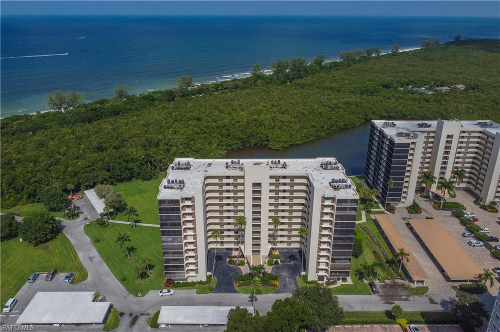Water, water everywhere! Glorious Gulf and Bay views from every room of your 10th floor spacious condo with a short stroll to the white, sandy beaches of Vanderbilt & Wiggins Pass State Park. The tranquil wrap around lanai allows you to watch both the sunrises and sunsets over the mangroves and preserve. Coveted covered parking plus a new AC provide peace of mind while the expansive pool and tiki hut are very private and overlook turkey bay, teeming with coastal herons, dolphin and manatee. Storage aplenty with walk-in closet plus extra storage areas across the hall and near the lobby. This community has it all including Tennis, Pickle Ball, Bocce, Boat Dock and Kayak lease spaces. Surf Colony is only minutes to the Ritz, Mercato, The Artis and an endless amount of shopping, dining and entertainment venues.
