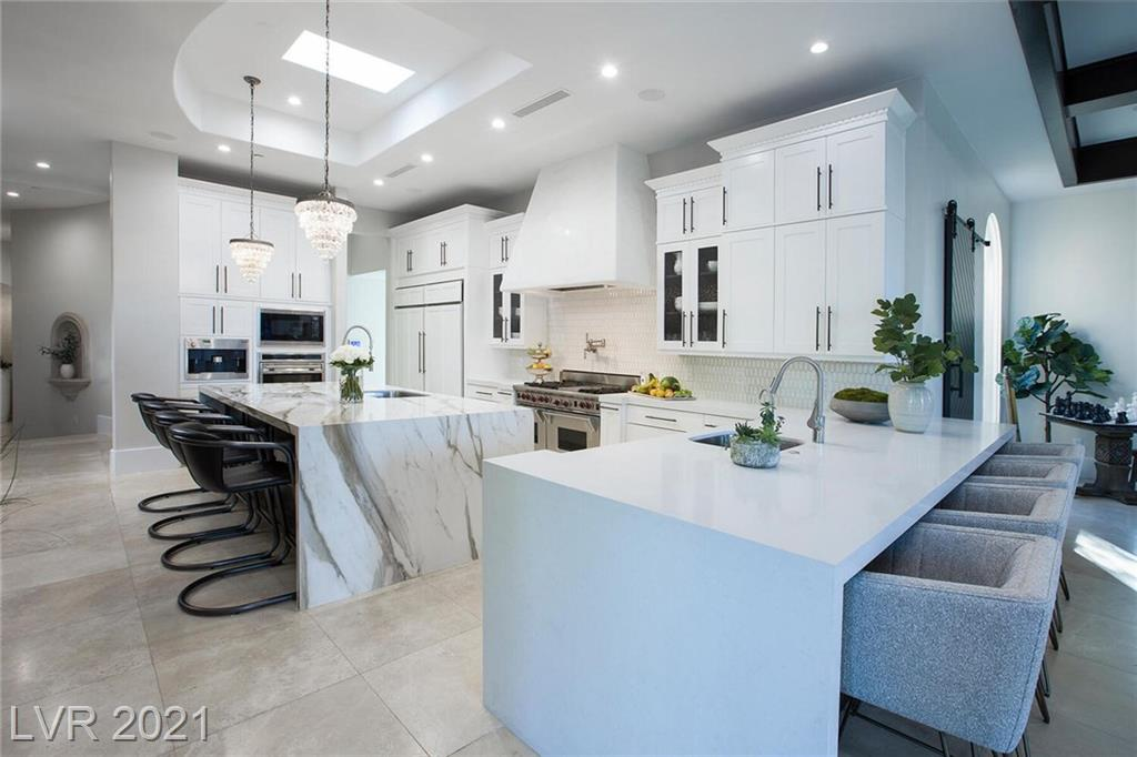 Santa Barbara-Style Custom Home in Anthem CC. Glamorous Modern Interiors w/Classic & Timeless Bckyrd & Outdoor Spaces.White Hues, Refined & Quality Finishes.Priv Oasis w/compound feels & beautiful views including some Strip,City & Mntn Views.Park behind and to side of house gives lots of space & room between neighbors.Fully Remodeled.Creston Smart Home Automation, Surround Sound Inside & Out. Theater/Media Rm, Game Rm/Loft, Gym, Office w/Built-Ins,Walk-In Wine Cellar,Chef's Kit w/Double Oversized Island,Bar Seating & Gourmet Wolf & Subzero Appls,Custom Lighting,Custom Cabinetry,Groin Vaults & Vaulted Din Rm.Master Retreat w/Bckyrd Entrance,Sep Vanities, Oversized Steam Shower, Architectural Tub, His & Her Closets. Resort Pool & Spa w/Waterfall Features, Sunken Outdoor Kitchen & BBQ Island with Swim Up Bar, Covered Loggia w/Bar and Strip Views, Covered Patios, Professional Landscaping & Outdoor Lighting. Exclusive Guard-Gated Country Club Community. Entertainer Paradise. Welcome Home.