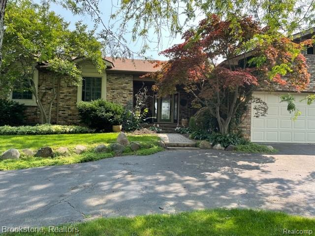 Beautiful Waterfront Brick Ranch with 83 feet of frontage on Lake Fenton! Open floor plan flows beautifully from the gourmet kitchen into the living area with lake views from the large windows flooding the rooms with light. Large master suite with walk in closet gives added space for storage.  The Large deck walks down to the patio to a cozy outdoor seating area, and boat dock. The Lower level Walkout gives easy access to the lake, and patio.  The lower level is finished with family room, bathroom, possible 4th bedroom or office. Enjoy boating, skiing, and swimming all summer long on beautiful Lake Fenton; close to restaurants, shopping, and schools.