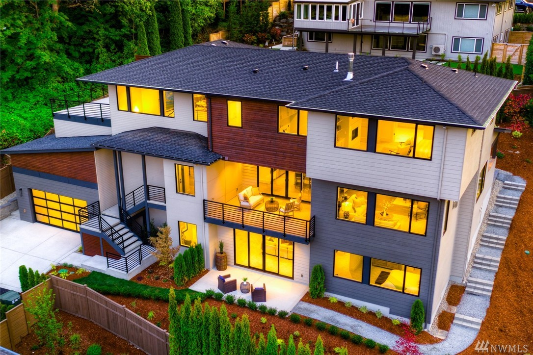 Address too new for GPS use 3105 113th Ave SE Bellevue (neighbor)5,006 sqft+ 500 sqft play room. Light filled open concept floorplan optimizes views of Factoria/Cascades. 5bed/6bath, 4-car tandem garage. Main floor with ensuite guest bed, great room, dining & chef's kitchen w/Wolf cooktop, ovens & SubZero fridge. Outdoor covered patio w/fireplace & heater, 2 decks showcase views. Upper floor Master retreat w/fireplace & bath w/heated floors. Lower level rec room w/kitchenette, ensuite guest bed.