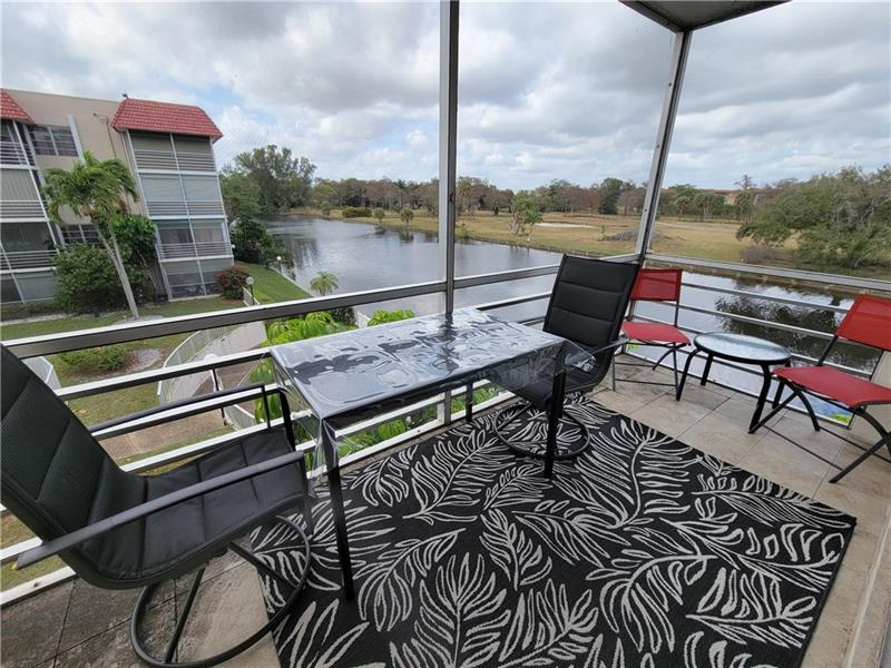 Turn key, fully furnished lovely corner condo with unreal views of canal and park and pool area.  Very light and bright with newer A/C 2015, water heater 2015. Las Vistas is a 55 plus community with multiple pools , shuffleboard and great walking areas nearby. Building roof was replaced in 2020.