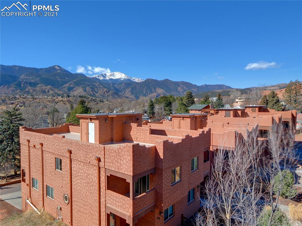 Rare opportunity to own a luxury, maintenance-free home in the perfect location! High-end finishes greet you as you walk through the door. Enjoy all that the Westside has to offer from your exclusive roof top deck while watching the sunset over Pikes Peak. This amazing townhome offers great entertaining spaces, a roof top deck with 360 degree views, three balconies, and maintenance free living! The kitchen features a gas range, pantry, beautiful custom tile backsplash with a walk out to a balcony with Pikes Peak views. The space is efficiently designed with each bedroom having its own bathroom and an extra half bath on the main level for guests. The kitchen welcomes you with custom tile, gorgeous granite, and stainless-steel appliances. On this deck is one of two natural gas grill hook-ups for you to grill out while enjoying a beautiful sunset! Make your way to the second floor where your master suite awaits you. A walk-in closet, tiled shower and oversized jetted bathtub are yours to enjoy! In the morning, open the blinds to unobstructed views of Pikes Peak, the front range, and Red Rock Canyon Open Space from your private deck off the master. Another bedroom, bathroom, and private deck are located on this floor. Next, you take one of many neighborhood trails on a short walk right into the Garden of the Gods. On the weekends, you walk to the farmer's market in Historic Old Colorado City or take a short walk to near by restaurants. A mere two miles from Manitou Springs & ten minutes from Downtown COS. A nearly 900 sq foot rooftop deck comes equipped with a storage closet, natural gas hook-up and 360 degree views! Dine al-fresco while watching the wildlife, sunrise, or sunset from the best view in Colorado Springs!