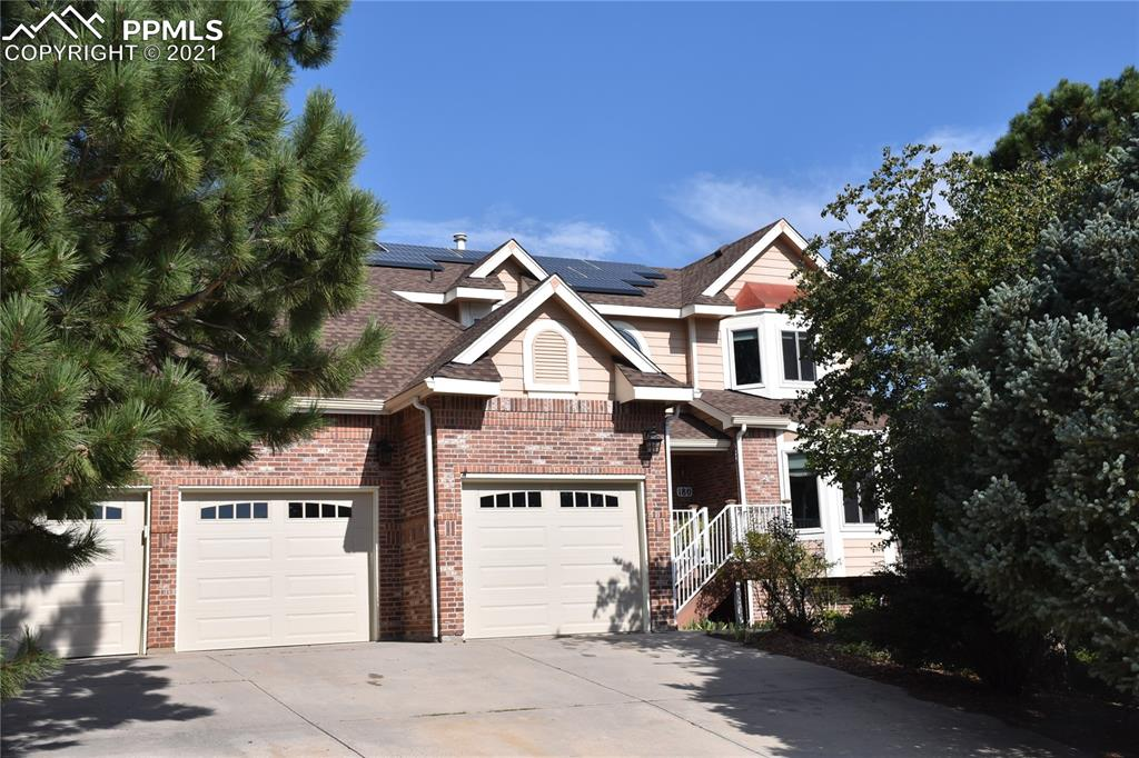 """Upgrade your lifestyle into this beautiful Gleneagle home, located on a quiet cul-de-sac.  Conveniently located  close to I25 for a commute either north to Denver or south and also within the boundaries of Academy School District 20, this 5 bedroom home has plenty of space for anyone.  Enter through the front door and in a few short steps enjoy the warmth of the high ceilinged family room with a gas log fireplace.  This is an """"open"""" floorplan, so if working in the kitchen creating delicious tidbits, one may still converse with family or guests.  Or step outside onto the composite deck.  On the main level are the spacious family room, living room, formal dining room, kitchen, laundry and also a roomy bedroom.  Upstairs, find the Master bedroom with vaulted ceiling and a window seat.  Attached, find the 5 piece bath with a spacious shower and walk-in closet.  2 additional bedrooms are located upstairs.  The basement sports an additional bedroom, a craft or exercise room and a great room.  Enjoy the roughly .4 acre lot which lends itself to some privacy in the rear.  This wonderful home also includes triple pane windows and a solar electric system which will significantly reduce your energy bills.  The 3 car garage is large enough for vehicles and other toys.  Come take a look!"""