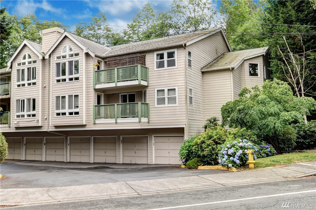 Bright & inviting 2 BR/2 BA top floor unit in booming Ballinger!  The open floor plan fills the spaces throughout with light all day long & offers a fireplace for chilly nights at home this fall. Enjoy morning coffee on the peaceful deck (accessed from all rooms of the house).  Walk in closet + private bath in main bedroom + laundry room and individual garage offer perks rarely seen in condo living.  Well-run, small HOA. Great access to shops, dining, grocery,  I-5 & Edmonds or LFP town center.