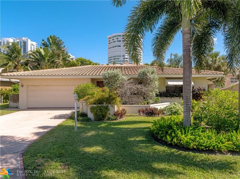 This is a wonderful opportunity to live in a fabulous beach community, BEL AIR in Lauderdale By The Sea.  This charming two bedroom and two and a half bath pool home has a great deal to offer.  Spacious living and dining areas, family room, large wood burning fireplace, two car garage, lush tropical landscaping, gorgeous wood floors, and much more.  The roof was replace in 2015.  The swimming pool was resurfaced a year ago.  New pool pump and motor.  Two zone AC.  Inviting curb appeal and on a great street.  Close to everything!