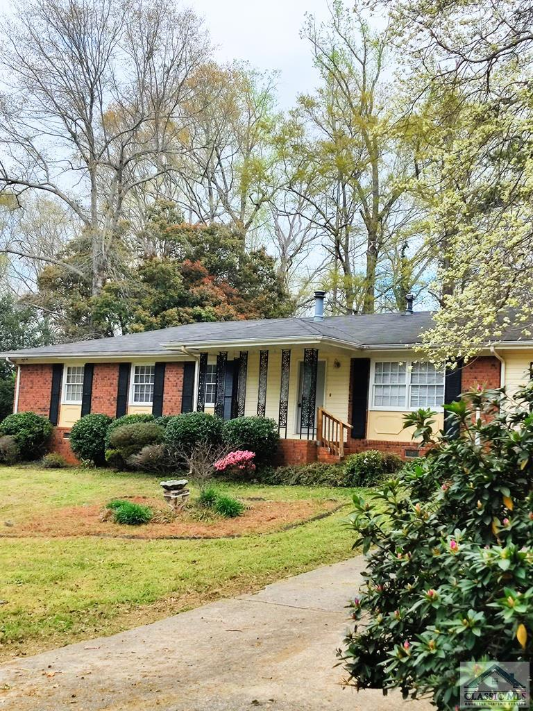 Desirable location! 2 miles away from University of Georgia. Close to Athens bypass. Newly painted and refinished hard wood floors thoughout. Additional great room with new LVP floor, perfect for entertaining. Fenced back yard. Ceiling fans in all the rooms.