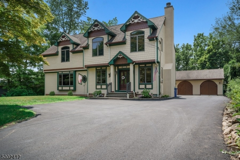 NEW LISTING! One-of-a-kind Victorian-style Colonial.  This  5 bedrooms. 2.1 bath sits on .69 acres. Beautiful craftsmanship around every corner. Custom kitchen with gorgeous wood floors. Family room with hand-crafted entertainment center. Coffered ceilings in 1st floor bedroom.(currently used as an office)  Master bedroom has a Juliet balcony over-looking the lush backyard. Lovely patio perfect for entertaining. 2 car garage currently a workshop. Minutes from Watchung lake, walking paths, restaurants and schools. Please come and see all this home has to offer.