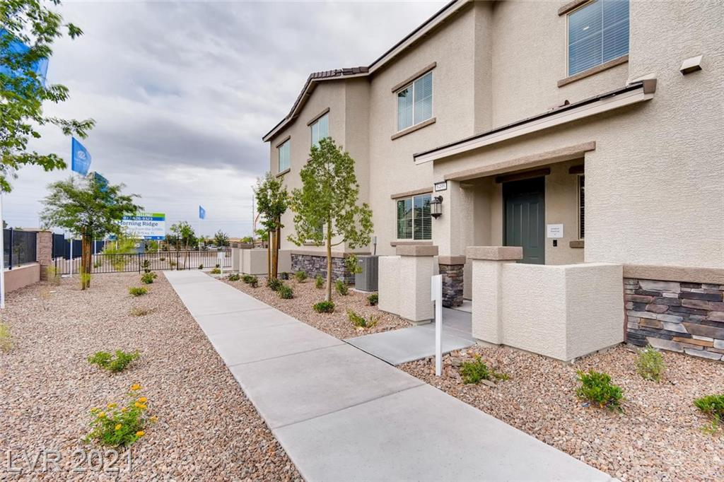 """Model Home in North Las Vegas! This home includes our """"Everything's Included"""" features such as stainless steel kitchen appliances, 2"""" faux wood blinds, Home Automation, USB outlets at kitchen & master, and much more!"""