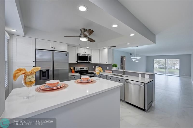 SPECTACULAR COMPLETELY REMODELED 2BEDROOM/2BATH WITH PANORAMIC LAKE/FOUNTAIN VIEW. BRAND NEW KITCHEN WITH WHITE QUARTZ COUNTER TOPS. BRAND NEW APPLIANCES. FLOORS THROUGHOUT. NEW A/C. REMODELED BATHROOMS WITH NEW SHOWERS.. EVERYTHING DONE WITH COMMUNITY AND CITY PERMITS. PRICE FOR A QUICK SALE!. ASSOC REQUIRES 20% DOWN & 1 OCCUP 55+