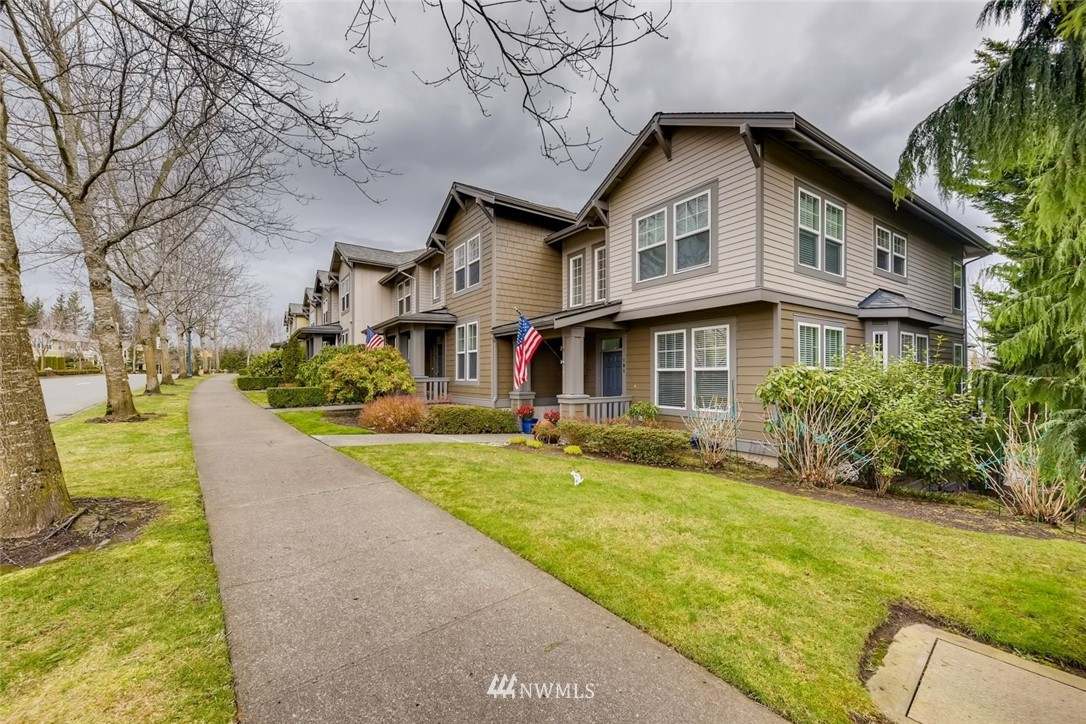 This absolutely gorgeous updated townhome is a must see! New high-end appliances, stunning quartz countertops in the kitchen, new wood floors, new carpet, new closets & new paint are just some of the updates. Modern, open floorplan with craftsman details throughout. Dual master suites with walk-in closets upstairs. Downstairs is a flex room perfect for office, bedroom or family room. Private deck with mountain views, new lighting, closet inserts and ceiling fans. No detail overlooked! Private garage & five-star Snoqualmie Ridge location close to dining, shopping, parks, trails & more. Don't miss out! Call today for immediate showings!