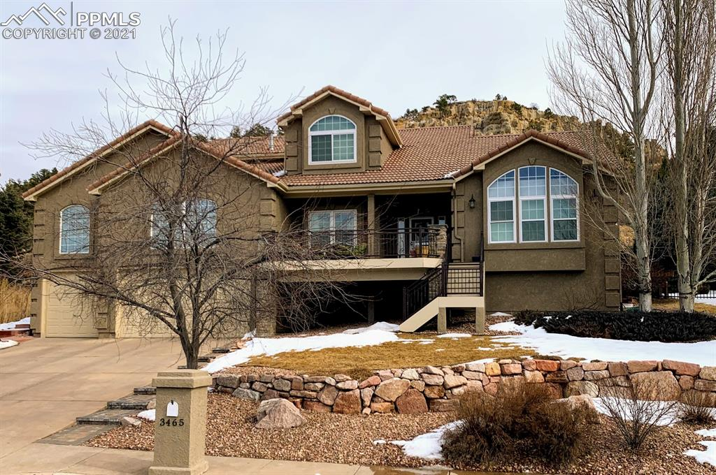 As you step into this updated home, the first thing you'll notice are the stunning bluffs outside the two-story wall of windows.  Backing up to 730 acres of open space, you'll have 26 miles of trails to explore.  Your bedroom and front deck have sweeping views of the front range and Pikes Peak.  When it is time to relax, downstairs there is a large home theater!  If you prefer to relax outside, there is a gazebo and granite island with a FireMagic burner and grill on a very private stamped concrete patio.