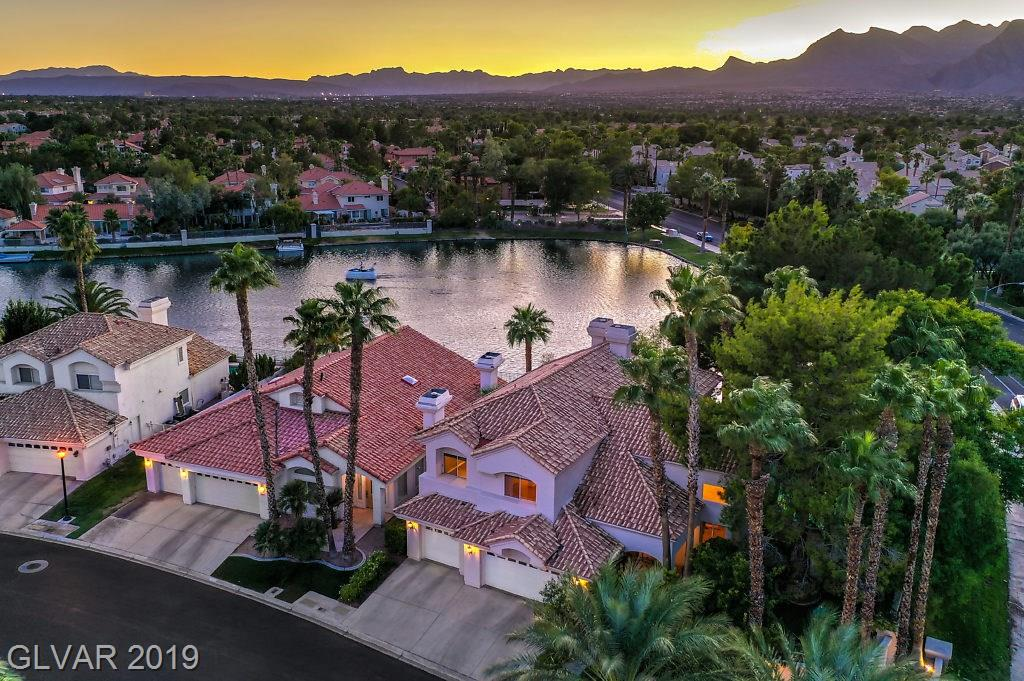 Unique opportunity to own a 1-of-a-kind LAKE HOUSE in Desert Shores w/private dock, b/i BBQ & secluded pool & hot tub. Spacious floor plan w/multiple living areas, dedicated office, wet bar & gas FP's. Designer kitchen w/granite, island, custom cabs, SS appl & b-fast nook. Master suite w/stunning lake views, wet bar, FP, huge w/i & jetted tub. Secondary BR's w/en-suites, sep laundry, storage, 3 car, gated community. Escape the ordinary!