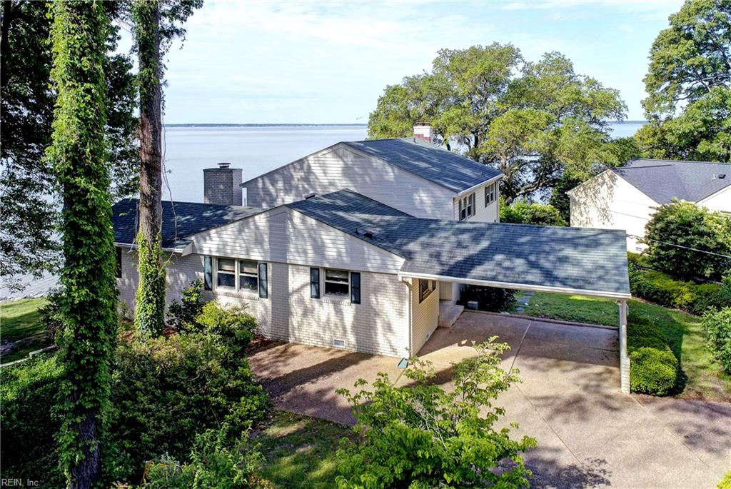 Magnificent view of the James River can be yours when you own 171' on the River. This home is seated on one of the most desirable pieces of property in Newport News. Not only does it have the best view but it shares a pier with a lift , water and lights for your fishing or boating pleasure.  The House was designed to take full advantage of the view giving the resident a feeling of serenity while being in the heart of Newport News. Flexible space in the design of this home meets your needs for either bedrooms or office space.  Three full bathrooms make for less sharing of those spaces and accommodates the bedrooms and your guest.  Sunsets are a kaleidoscope of colors that are not easy to capture unless you are there to see it for yourself.  Come and see for yourself, we welcome you to share in its beauty.