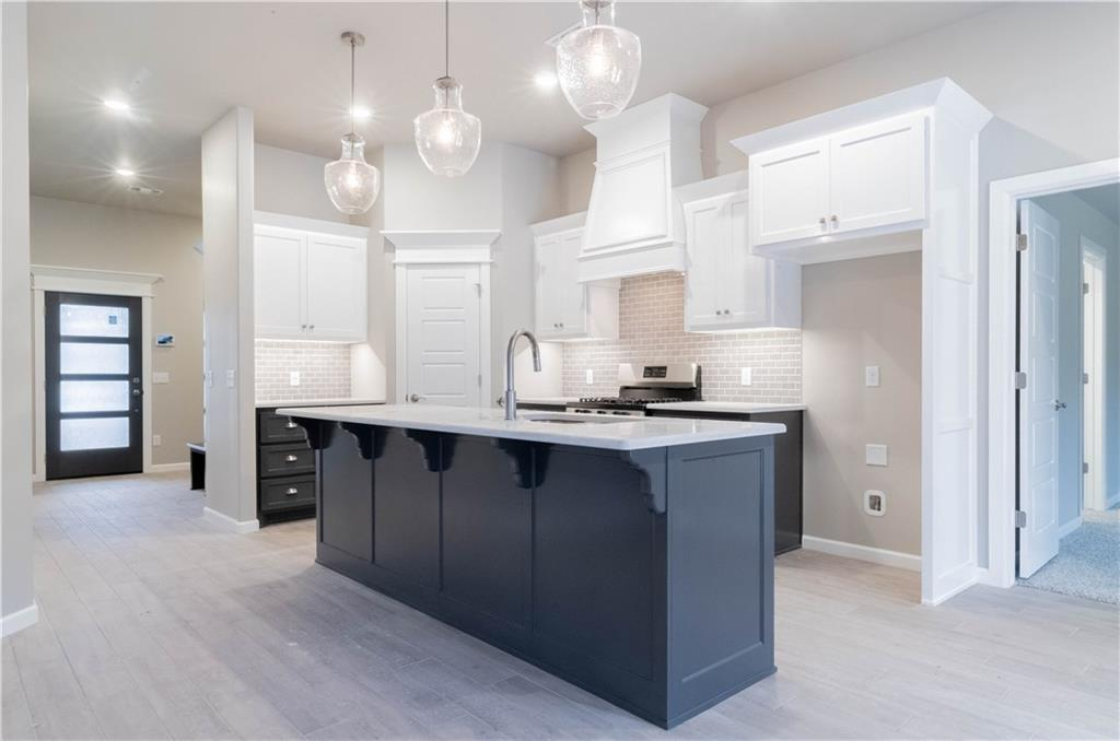 A stunning Herringbone Wood Look Tile entry way will greet you in this adorable Julie Floorplan in Woodland Park. Home includes 1,830 Sq Ft of total living space, which includes 1,700 Sq Ft of indoor living space and 130 Sq Ft of outdoor living space. Home has 4 bedrooms, 2 full bath. Storm shelter included in the 2 car garage. Back patio has an outdoor fireplace, great for entertaining friends and family. Living Area has gorgeous gas ignition fireplace, with stack stone surround and wood look tile as main flooring. Kitchen has 3CM quartz countertops, slide in gas range, and spacious walk in pantry. Master suite features a boxed ceiling detail with crown molding and bathroom featuring separate vanities, large walk in sauna shower, whirlpool tub and spacious walk in closet! Walk in closet has access to Utility room! Other amenities include Smart Home technology, a whole home air filtration system, Rinnai Tankless water heater, R-44 insulation and a TechShield radiant barrier!