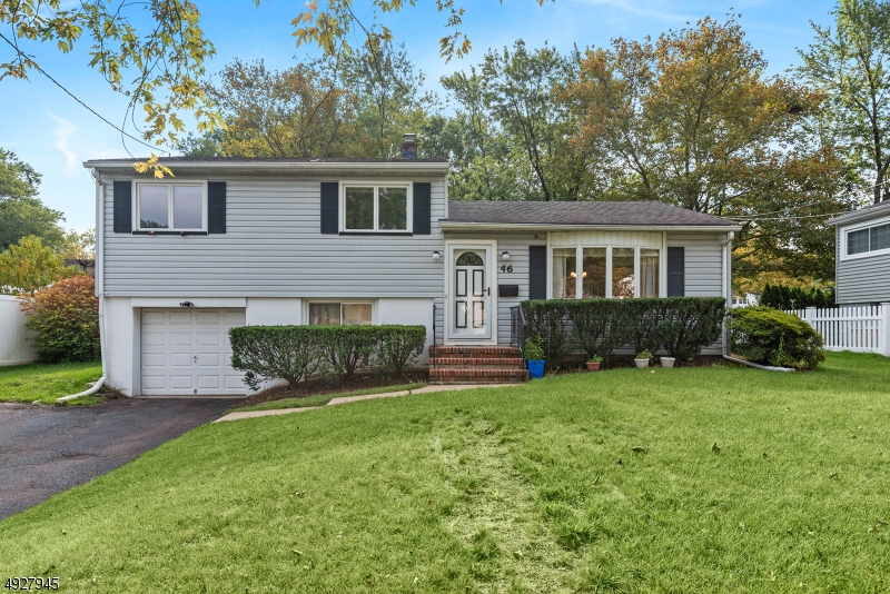 Fanwood train is .5 mile away and bus to Port Authority is also close distance. Beautiful and bright move in condition home which features 3 bedrooms, 2 baths and a bonus family room.  Open floor layout, living room, dining room and family room are all open to each other with plenty of windows.  Perfect for entertainment.  Remodeled kitchen with granite countertops and stainless appliances.  All bathrooms have also been remodeled.    Hardwood floors are available in living and dining room.  All bedrooms have refinished hardwood floors. Recreation room on 1st floor has new carpet and renovated full bathroom with shower stall.   Lots of storage and closets.  Backyard is flat and private.