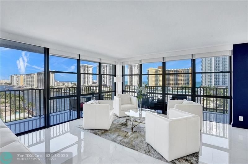 WHAT AN AMAZING UNOBSTRUCTED VIEW OF THE INTRACOASTAL AND OCEAN.  JUST SIT ON YOUR WRAPAROUND BALCONY FACING NORTH AND EAST TO ENJOY THIS VIEW AND THE BOATS PASSING BY.  ALL REMODELED WITH A DESIGNER TASTE.   THIS UNIT IS BEING SOLD WITH EVERYTHING, JUST BRING YOUR TOOTHBRUSH.  LOOK AT THE PICTURES AND YOU WILL FALL IN LOVE WITH THIS CORNER UNIT.  THIS IS A MUST SEE.