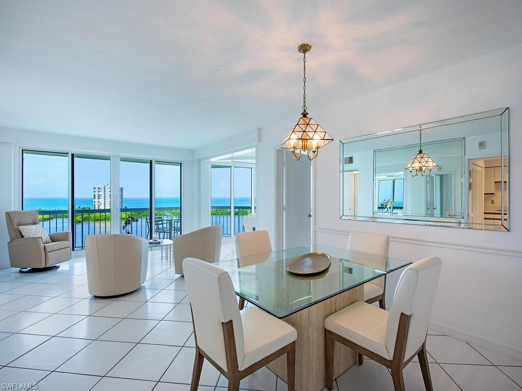 Stunning, panoramic, Gulf of Mexico and Bay views from the 11th floor, 2 bedrooms, 2 bath unit. All new impact windows and doors. Tile throughout. Open, bright, great for entertaining. Turnkey, move right in and enjoy!   St Tropez is conveniently located steps from the tram path for quick and easy beach access. Enjoy the recently renovated coastal chic lobby and amenities. St Tropez has its own swimming pool, outdoor grills, tennis court, fitness room, extra storage, social room and guest suites.  All Pelican Bay members enjoy 2 beach restaurants, attended beach service, fitness center, 18 har-tru tennis courts, learning center, kayaking, biking, mile of walking nature paths and so much more.  Artis Naples Performing Arts Center, Waterside Shops and Mercato are just minutes away.