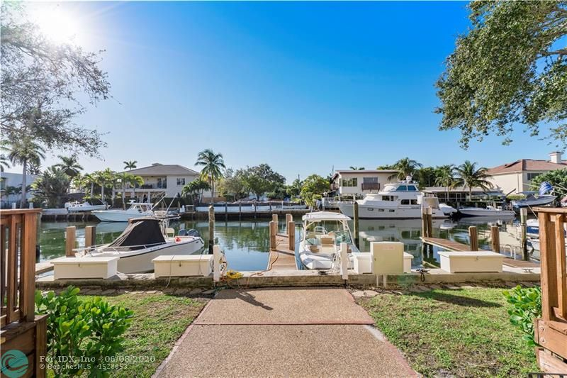Rio Vista townhouse with private dock for a 35' boat. Widest boat slip in the complex including Power Pedestal w/30amps & Freshwater Tap. Just off the Intracoastal only 10 minutes to the ocean! Corner cozy townhome, remodeled, new floors, custom kitchen with granite countertops, crown moldings, fireplace in living room. Close to shops, restaurants, airport. Perfect way to enjoy Florida having your boat in your backyard! Complex waterfront area and landscape are in the process of being improved and redone. Seawall will be raised to comply with new City requirements. All these costs have been funded already by current owner. Monthly $750 fee includes Reserves, Windstorm, Bldg. Liability & Flood Insurance, Pest Control, Outside maintenance & landscaping. Amazing location & value!