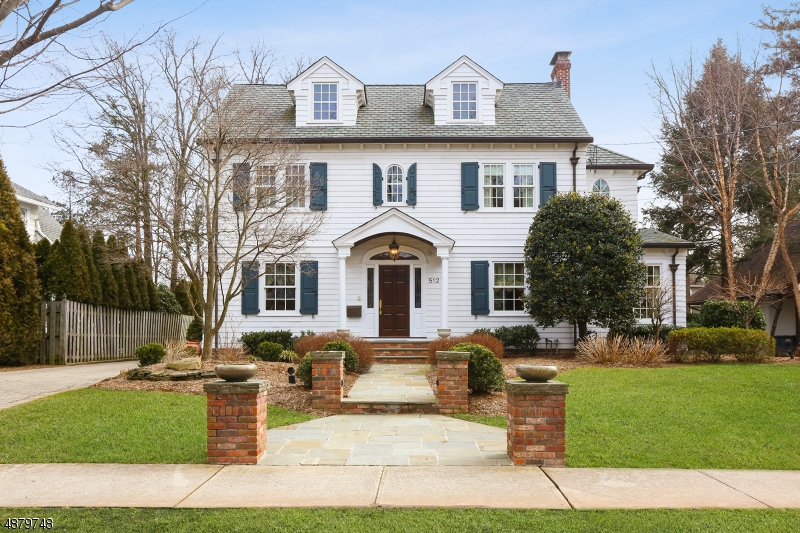 This Classic Center Hall Colonial located in the prestigious Gardens section of Westfield is a true treasure. Exceptional quality & exquisite architectural design w/Marvin Architectural series windows , Grand Manor roof, cedar siding, copper leaders/gutters, PROF landscaped w/paver DRWY, blue stone walkway & 2 car DET GAR. Amenities include warm rich HWFLRS, raised panels, decorative trim & chair railing thru-out. FLEX open FLR plan includes 4/5 BRs, 5.5 BAs, FDR w/butlers pantry, KIT by Canterbury Design, professional SS APPL & travertine CTPs. Breakfast area w/herringbone patterned WD FLR w/French door leading to a 2 tier patio & pergola that overlooks a PRI YD. 2nd FLR w/light & bright BRs. MST BR suite offers sitting area, 2 walk-in closets & PRI BA. Open staircase to FIN LL W/REC RM, full BA & LDRY RM.